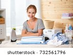 happy woman housewife ironing... | Shutterstock . vector #732561796