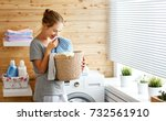 Stock photo a happy housewife woman in laundry room with washing machine 732561910