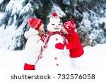 children build snowman. kids... | Shutterstock . vector #732576058