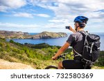 a young guy on a mountain bike... | Shutterstock . vector #732580369