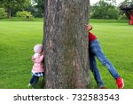 two children play hide and seek | Shutterstock . vector #732583543