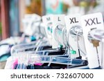 Small photo of Large Size clothing hangers on outside rack