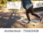 young girl riding a skateboard. ... | Shutterstock . vector #732623428