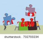 little men collect a puzzle... | Shutterstock .eps vector #732703234