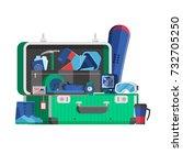 winter travel suitcase stuffed... | Shutterstock .eps vector #732705250