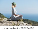 yoga woman sitting on the top... | Shutterstock . vector #732766558