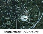 disc golf basket in the rain | Shutterstock . vector #732776299