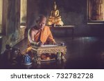 the monk is sitting and writing ... | Shutterstock . vector #732782728