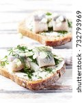 Stock photo canapes with cream cheese salted herring onion and herbs close up 732793969