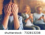 Small photo of Depressed daughter in total ignorance of egoistic parents
