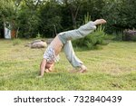 child doing yoga exercise... | Shutterstock . vector #732840439