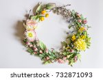 wreath of artificial flowers  | Shutterstock . vector #732871093