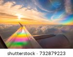 wing of an airplane flying... | Shutterstock . vector #732879223