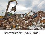 Excavator Is Loading Scrap...