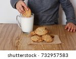 a child is dunking a cookie in... | Shutterstock . vector #732957583
