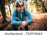 Happy Male Cyclist In Forest.