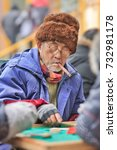 Small photo of BEIJING-JANUARY 9, 2015. Old man smoking a cigar. China is aging more rapidly than almost any country in recent history. China's dependency ratio for retirees could rise as high as 44% by 2050.