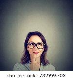 cute thoughtful happy woman in... | Shutterstock . vector #732996703