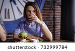 the girl at the restaurant is... | Shutterstock . vector #732999784