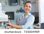 barista making coffee  | Shutterstock . vector #733004989