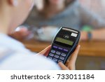 customer paying through credit... | Shutterstock . vector #733011184