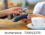 customer paying through mobile... | Shutterstock . vector #733012270