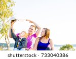 happy family outside | Shutterstock . vector #733040386
