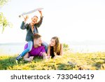 happy family outside | Shutterstock . vector #733040419