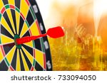 Small photo of Arrow aim goal on board target with success business.