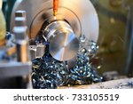 Professional machinist. Horizontal shot of a man operating lathe grinding machine metalworking industry concept copyspace - stock photo