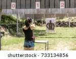 woman aiming pistol at target... | Shutterstock . vector #733134856