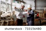 two male engineers are standing ... | Shutterstock . vector #733156480