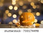 halloween pumpkin with candles... | Shutterstock . vector #733174498