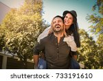 happy young couple laughing and ... | Shutterstock . vector #733191610