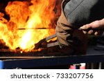a blacksmith at work with... | Shutterstock . vector #733207756