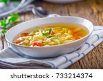 chicken broth. bone broth with... | Shutterstock . vector #733214374