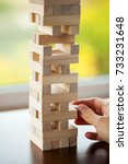 the tower from wooden blocks... | Shutterstock . vector #733231648