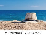 men's sunhat on the beach sand... | Shutterstock . vector #733257640