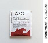 Small photo of Washington, DC - October 12, 2017: Tazo brand Awake English Breakfast tea bag.