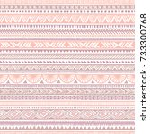 Seamless ethnic pattern. Tribal and aztec motifs. Striped vintage print. Pink, purple and white colors. Trend print for textiles. Vector illustration. | Shutterstock vector #733300768