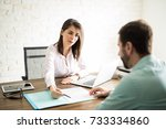 business woman talking to a... | Shutterstock . vector #733334860