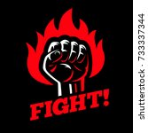 clenched raised fist in fire on ... | Shutterstock .eps vector #733337344