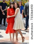 "Small photo of CANNES, FR - May 21, 2017: Stacy Martin & Berenice Bejo at the photocall for ""The Formidable"" (Le Redoutable) at the 70th Festival de Cannes"