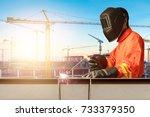industrial welder welding... | Shutterstock . vector #733379350