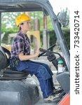 the woman forklift operator | Shutterstock . vector #733420714