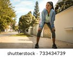 young woman exercise outside.... | Shutterstock . vector #733434739