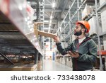 warehouse manager checking his... | Shutterstock . vector #733438078