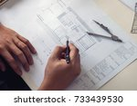 architect working on blueprint  ... | Shutterstock . vector #733439530