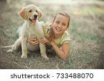 Small photo of Retriever pup Lovely scene cute young teen girl enjoying posing summer time vacation with best friend dog ivory white labrador puppy.Happy airily careless childhood life world of dreams with puppies.