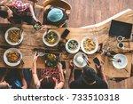 group of happy friends having... | Shutterstock . vector #733510318
